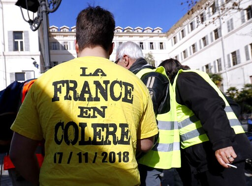 """(Riccardo Antimiani/ANSA via AP). A man wears a yellow shirt with writing in French reading """"France in anger"""" during a demonstration of Italian and French yellow vests, in Sanremo, Italy, Friday, Feb. 8, 2019. France's government spokesman said that th..."""