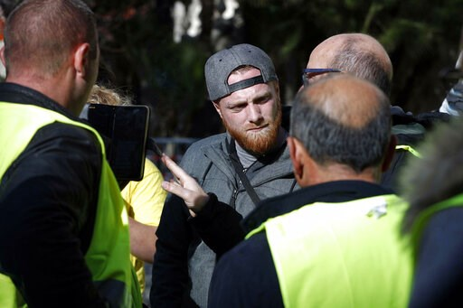 (Riccardo Antimiani/ANSA via AP). French activist of the 'Gilets Jaunes' (Yellow Vests) movement, Maxime Nicolle, center, attends a demonstration of Italian and French yellow vests, in Sanremo, Italy, Friday, Feb. 8, 2019. France's government spokesman...