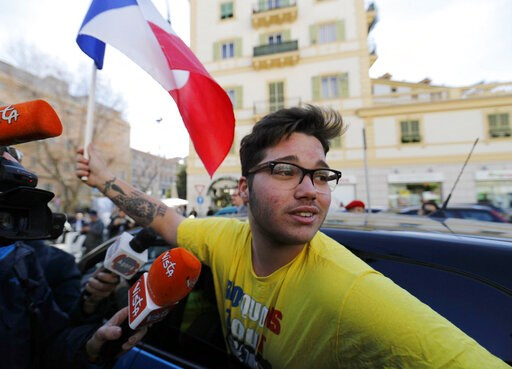 (Riccardo Antimiani/ANSA via AP). An activist wearing a yellow shirt and waving a French flag attends a demonstration of Italian and French yellow vests, in Sanremo, Italy, Friday, Feb. 8, 2019. France's government spokesman said that the recall of the...