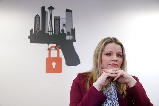 (AP Photo/Elaine Thompson). In this Thursday, Feb. 7, 2019 photo, Kimberly Wyatt, a King County senior deputy prosecutor who is part of a regional unit that enforces Extreme Risk Protection Orders (ERPO), poses for a portrait near the logo for the unit...