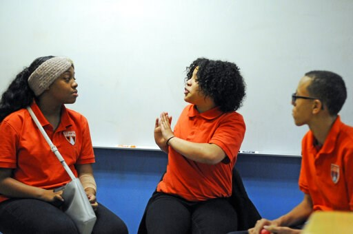 (AP Photo/Benny Snyder). In this Nov. 15, 2018 photo, students participate in a Youth Aware of Mental Health session at Uplift Hampton Preparatory School in Dallas. University of Texas Southwestern Medical Center offers the program to schools to help e...