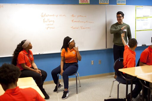 (AP Photo/Benny Snyder). In this Nov. 15, 2018 photo, Marshall Motsenbocker, standing right, a researcher at the University of Texas Southwestern Medical Center, leads a Youth Aware of Mental Health session at Uplift Hampton Preparatory School in Dalla...
