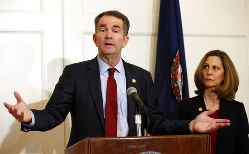 (AP Photo/Steve Helber). In this Feb. 2, 2019, photo, Virginia Gov. Ralph Northam, left, accompanied by his wife, Pam, speaks during a news conference in the governor's mansion in Richmond, Va. Democrats are hoping there's a silver lining to the Northa...