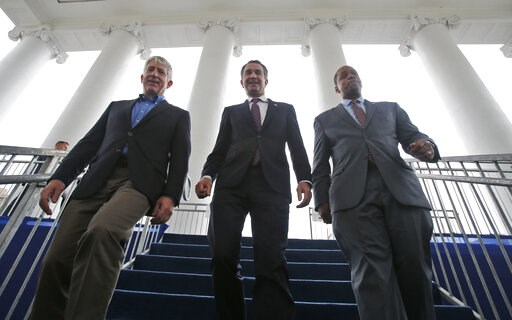 (AP Photo/Steve Helber, File). FILE - In this Jan. 12, 2018 file photo, Virginia Gov.-elect, Lt. Gov Ralph Northam, center, walks down the reviewing stand with Lt. Gov-elect, Justin Fairfax, right, and Attorney General Mark Herring at the Capitol in Ri...