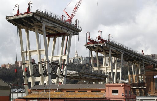 (AP Photo/Antonio Calanni). A view of of the Morandi bridge in Genoa, Italy, Saturday, Feb. 9, 2019. Workers taking apart the remains of a bridge which collapsed in Aug. 2018 are set to remove a 40 meter beam, seen in between the red machinery. A large...