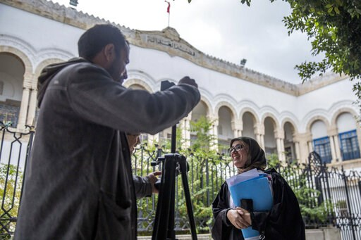 (AP Photo/Hassene Dridi). Imen Triqui, one of the defense lawyers talks to the Associated Press outside the Hall of Justice in Tunis, Friday, Feb.8, 2019. More than 40 people have been summoned to face trial over Tunisia's deadliest attack in a Mediter...