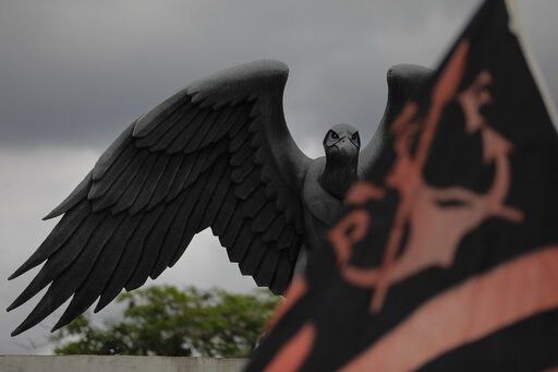 (AP Photo/Leo Correa). A statue of a vulture, the mascot symbol of Brazil's Flamengo soccer team, is seen atop the entrance of the soccer club training complex in Rio de Janeiro, Brazil, Friday, Feb. 8, 2019. A fire tore through the sleeping quarters o...