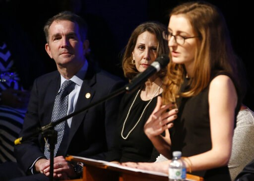 (AP Photo/Steve Helber, Pool). Virginia Gov. Ralph Northam, left, and his wife Pam, seated, listen to Ereica Dowell, right, sister of fallen Virginia State Trooper Lucas B. Dowell during the funeral at the Chilhowie Christian Church in Chilhowie, Va., ...