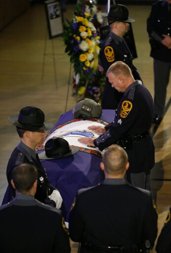 (AP Photo/Steve Helber, Pool). Virginia State troopers shed tears as they pay their respects prior to the funeral of fallen Virginia State Trooper Lucas B. Dowell at the Chilhowie Christian Church in Chilhowie, Va., Saturday, Feb. 9, 2019. Dowell was k...
