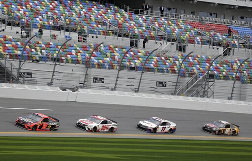 (AP Photo/John Raoux). NASCAR drivers, from left, Martin Truex Jr. (19), Erik Jones (20), Denny Hamlin (11) and Kyle Busch (18) runs practice laps during auto race practice at Daytona International Speedway, Saturday, Feb. 9, 2019, in Daytona Beach, Fla.