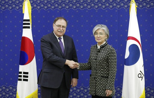 (AP Photo/Lee Jin-man, Pool). South Korean Foreign Minister Kang Kyung-wha, right, and Timothy Betts, acting Deputy Assistant Secretary and Senior Advisor for Security Negotiations and Agreements in the U.S. Department of State, shake hands for the med...