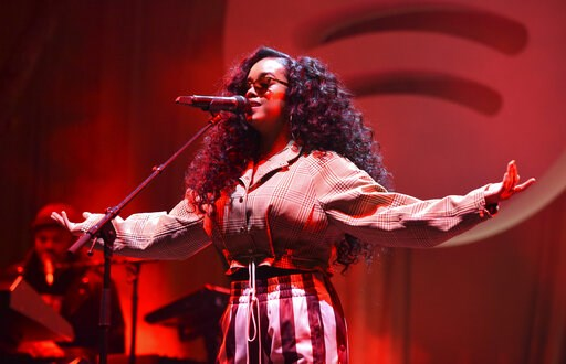 (Photo by Phil McCarten/Invision/AP). H.E.R. performs at the Spotify Best New Artist 2019 Party at The Hammer Museum on Thursday, Feb. 7, 2019, in Los Angeles.