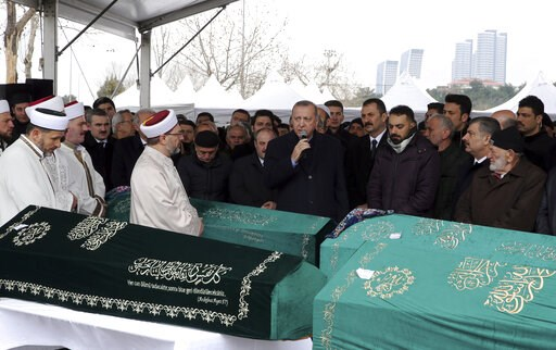 (Presidential Press Service via AP, Pool). Turkey's President Recep Tayyip Erdogan, center, speaks as he joins hundreds of mourners who attend the funeral prayers for nine members of Alemdar family killed in a collapsed apartment building, in Istanbul,...