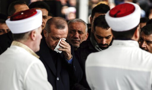 (AP Photo/Emrah Gurel). Turkey's President Recep Tayyip Erdogan, center, reacts as he joins hundreds of mourners who attend the funeral prayers for nine members of Alemdar family killed in a collapsed apartment building, in Istanbul, Saturday, Feb. 9, ...