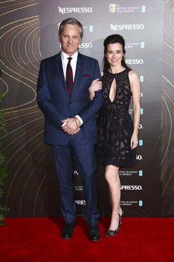 (Photo by Joel C Ryan/Invision/AP). Actors Viggo Mortensen, left, and Linda Cardellini pose for photographers upon arrival at the BAFTA Nominees Party in London, Saturday, Feb. 9, 2019.