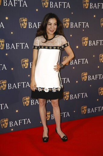 (Photo by Grant Pollard/Invision/AP). Actress Michelle Yeoh poses for photographers on arrival at a BAFTA Fundraising Gala in London, Friday, Feb. 8, 2019.