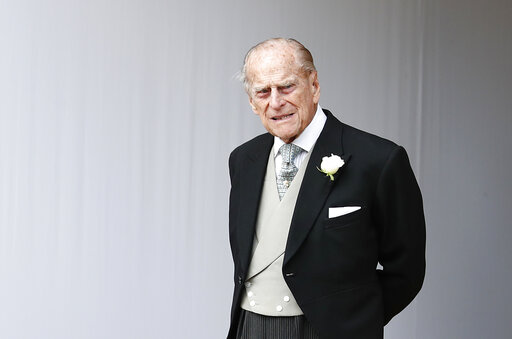 (AP Photo/Alastair Grant, Pool, File). FILE - In this Friday, Oct. 12, 2018 file photo, Britain's Prince Philip waits for the bridal procession following the wedding of Princess Eugenie of York and Jack Brooksbank in St George's Chapel, Windsor Castle,...