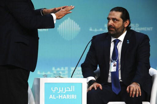 (AP Photo/Jon Gambrell). Lebanese Prime Minister Saad Hariri listens as a moderator gestures toward him while emphatically asking a question about how to pitch Lebanon to investors, during the World Government Summit in Dubai, United Arab Emirates, Sun...