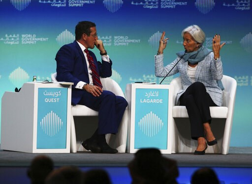 (AP Photo/Jon Gambrell). International Monetary Fund Managing Director Christine Lagarde, right, gestures at moderator Richard Quest, while speaking during the World Government Summit in Dubai, United Arab Emirates, Sunday, Feb. 10, 2019. Lagarde on Su...