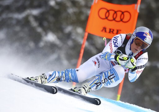 (AP Photo/Alessandro Trovati). Lindsey Vonn speeds down the course during the women's downhill race, at the alpine ski World Championships in Are, Sweden, Sunday, Feb. 10, 2019.