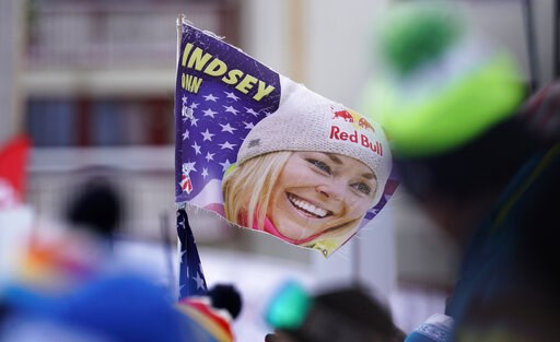 (AP Photo/Giovanni Auletta). Supporters hold a flag with a portrait of United States' Lindsey Vonn in the finish area prior to the start of the women's downhill race, at the alpine ski World Championships in Are, Sweden, Sunday, Feb. 10, 2019.