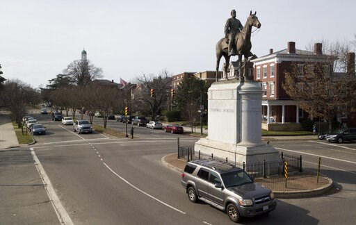 (AP Photo/Steve Helber). In this Jan. 27, 2019, photo traffic passes by the statue of Confederate General Stonewall Jackson at the intersection Traffic passes by the statue of Confederate General Stonewall Jackson at the intersection of Monument Avenue...