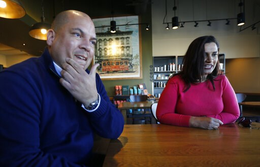(AP Photo/Steve Helber). In this Jan. 10, 2019, photo David Harris Jr., left, the nephew of Arthur Ashe, and Richmond City Council member, Kim Gray, right, gesture during an interview in Richmond, Va. The duo are attempting to get the Boulevard renamed...