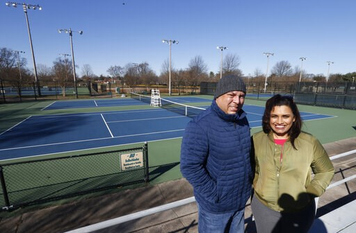 (AP Photo/Steve Helber). In this Jan. 10, 2019, photo David Harris Jr., left, the nephew of Arthur Ashe, and Richmond City Council member, Kim Gray, right, pose at the tennis courts on the Boulevard which were tennis star Arthur Ashe was banned from in...