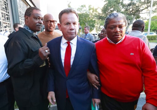 (AP Photo/Wilfredo Lee, File). FILE- In this Jan. 11, 2019, file photo, suspended Broward County Sheriff Scott Israel, center, leaves a news conference surrounded by supporters in Fort Lauderdale, Fla., after new Florida Gov. Ron DeSantis suspended him...