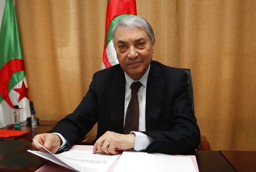(AP Photo/Anis Belghoul, File). FILE - In this March 29, 2018 file photo, former Algerian Prime Minister Ali Benflis talks to the Associated Press in Algiers. More than 180 people want to run for president of Algeria in the April election, amid growing...