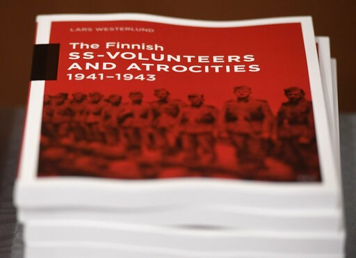 (Heikki Saukkomaa/Lehtikuva via AP). The research document entitled The Finnish SS-volunteers and atrocities 1941 - 1943 against Jews, detailing atrocities against civilians and Prisoners of War in Ukraine and the Caucasus Region, pictured in Helsinki,...