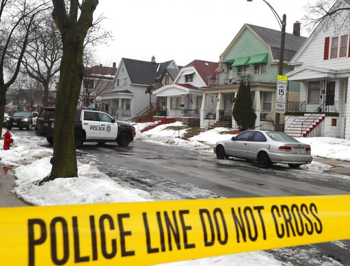 (Rick Wood/Milwaukee Journal-Sentinel via AP). Milwaukee Police cars are stationed in a neighborhood where Milwaukee Police Officer Matthew Rittner was killed in Milwaukee on Thursday, Feb. 7, 2019. Police are collecting evidence at a Milwaukee home wh...