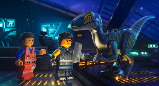 "(Warner Bros. Pictures via AP). This image released by Warner Bros. Pictures shows the characters Emmet, left, and Rex Dangervest, center, both voiced by Chris Pratt, in a scene from ""The Lego Movie 2: The Second Part."""