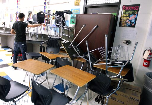 (Rachel Denny Clow/Corpus Christi Caller-Times via AP, File). FILE - In this Jan. 22, 2013, file photo, a student helps block the classroom door with furniture during a mock lockdown drill at Moody High School in Corpus Christi, Texas. With each subseq...