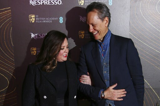 (Photo by Joel C Ryan/Invision/AP). Actors Melissa McCarthy, left, and Richard E. Grant pose for photographers upon arrival at the BAFTA Nominees Party in London, Saturday, Feb. 9, 2019.