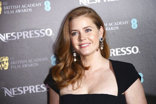 (Photo by Joel C Ryan/Invision/AP). Actress Amy Adams poses for photographers upon arrival at the BAFTA Nominees Party in London, Saturday, Feb. 9, 2019.