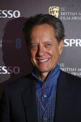 (Photo by Joel C Ryan/Invision/AP). Actor Richard E. Grant poses for photographers upon arrival at the BAFTA Nominees Party in London, Saturday, Feb. 9, 2019.