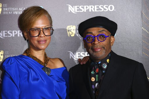 (Photo by Joel C Ryan/Invision/AP). Director Spike Lee, right, and producer Tonya Lewis Lee pose for photographers upon arrival at the BAFTA Nominees Party in London, Saturday, Feb. 9, 2019.