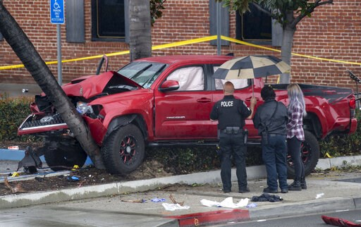 (Mindy Schauer/The Orange County Register via AP). Fullerton Police investigate an early-morning accident that injured several pedestrians, Sunday, Feb. 10, 2019, in Fullerton, Calif. Authorities say a suspected drunken driver was arrested after his pi...