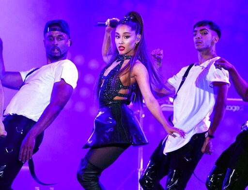 (Photo by Chris Pizzello/Invision/AP, File). FILE - In this June 2, 2018 file photo, Ariana Grande, center, performs at Wango Tango in Los Angeles. Grande won her first Grammy Award on Sunday, Feb. 10, but the singer didn't collect it after she decided...