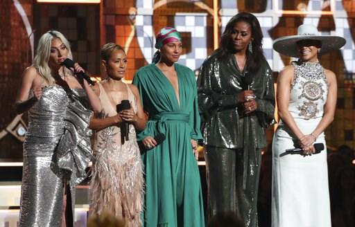 (Photo by Matt Sayles/Invision/AP). Lady Gaga, from left, Jada Pinkett Smith, Alicia Keys, Michelle Obama and Jennifer Lopez speak at the 61st annual Grammy Awards on Sunday, Feb. 10, 2019, in Los Angeles.