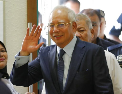 (AP Photo/Vincent Thian, File). FILE - In this Oct. 4, 2018, file photo, former Malaysian Prime Minister Najib Razak walks into courtroom at Kuala Lumpur High Court in Kuala Lumpur, Malaysia. Najib is hardly lying low ahead of his corruption trial set ...