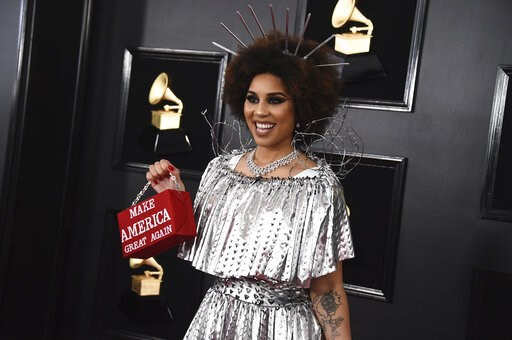 "(Photo by Jordan Strauss/Invision/AP). Joy Villa holds a purse that reads ""Make America Great Again"" at the 61st annual Grammy Awards at the Staples Center on Sunday, Feb. 10, 2019, in Los Angeles."