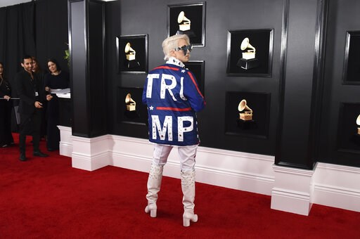(Photo by Jordan Strauss/Invision/AP). Ricky Rebel arrives at the 61st annual Grammy Awards at the Staples Center wearing a jacket with the word Trump on it, on Sunday, Feb. 10, 2019, in Los Angeles.