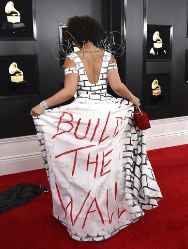 "(Photo by Jordan Strauss/Invision/AP). Joy Villa arrives at the 61st annual Grammy Awards at the Staples Center wearing a dress that reads ""Build the Wall"" on Sunday, Feb. 10, 2019, in Los Angeles."