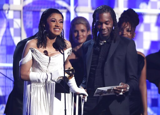 "(Photo by Matt Sayles/Invision/AP). Cardi B, left, accepts the award for best rap album for ""Invasion of Privacy"" as Offset looks on at the 61st annual Grammy Awards on Sunday, Feb. 10, 2019, in Los Angeles."
