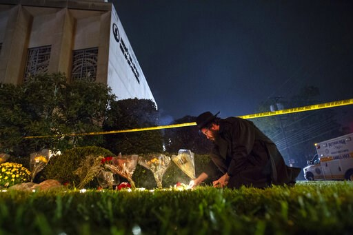 (Steph Chamber/Pittsburgh Post-Gazette via AP, File). FILE - In this Oct. 27, 2018 photo, Rabbi Eli Wilansky lights a candle after a mass shooting at Tree of Life Synagogue in Pittsburgh's Squirrel Hill neighborhood. Robert Bowers, a truck driver accus...