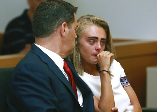 (Matt West/The Boston Herald via AP, Pool, File). FILE - In a Thursday, Aug. 3, 2017 file photo, Michelle Carter awaits her sentencing in a courtroom in Taunton, Mass., for involuntary manslaughter for encouraging Conrad Roy III to kill himself in July...