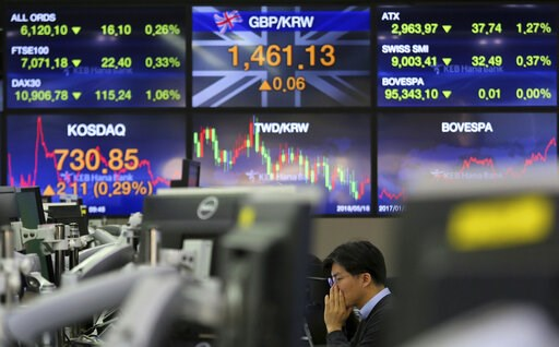 (AP Photo/Ahn Young-joon). A currency trader watches monitors at the foreign exchange dealing room of the KEB Hana Bank headquarters in Seoul, South Korea, Monday, Feb. 11, 2019. Asian stocks were mixed on Monday as traders watched for developments on ...