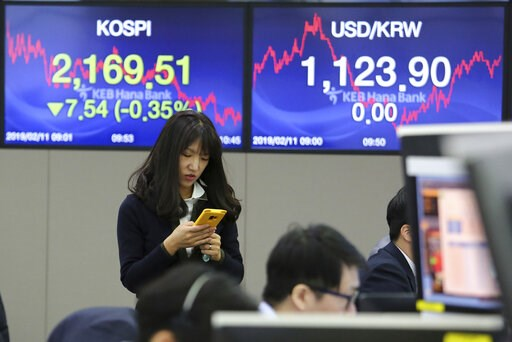 (AP Photo/Ahn Young-joon). A currency trader watches her smartphone at the foreign exchange dealing room of the KEB Hana Bank headquarters in Seoul, South Korea, Monday, Feb. 11, 2019. Asian stocks were mixed on Monday as traders watched for developmen...